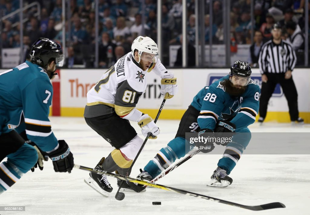 Jonathan Marchessault #81 of the Vegas Golden Knights tries to skate between Brent Burns #88 and Paul Martin #7 of the San Jose Sharks during Game Three of the Western Conference Second Round during the 2018 NHL Stanley Cup Playoffs at SAP Center on April 30, 2018 in San Jose, California.