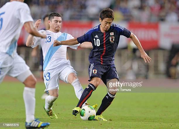 Jonathan Marquez of Guatemala and Shinji Kagawa of Japan in action during the international friendly match between Japan and Guatemala at...