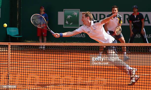 Jonathan Marray and Colin Fleming of Great Britain in action against Julian Knowle of Austria and Frederik Nielsen of Denmark in their first round...