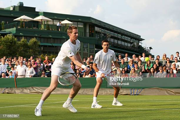 Jonathan Marray and Colin Fleming of Great Britain in action during the Gentlemen's Doubles first round match between Colin Fleming of Great Britain...