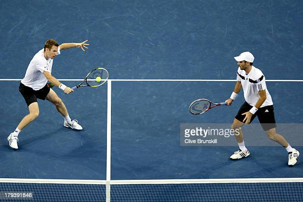Jonathan Marray and Colin Fleming of Great Britain play Bob and Mike Bryan on Day Eight of the 2013 US Open at USTA Billie Jean King National Tennis...