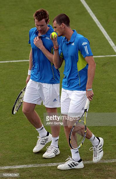 Jonathan Marray and Jamie Murray of Great Britain speak to one another during their first round doubles match on day one of the AEGON International...