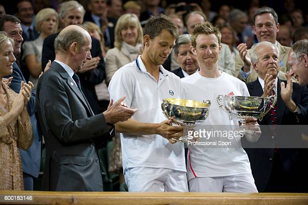 Jonathan Marray of Great Britain and Frederik Nielsen of Denmark hold their winners' trophies after winning their Gentlemans Doubles final match...