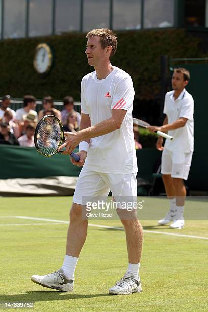 Jonathan Marray of Great Britain and Frederik Nielsen of Denmark in action during their Gentlemen's Doubles first round match against Marcel...