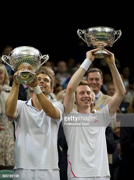Jonathan Marray of Great Britain and Frederik Nielsen of Denmark lift their winners' trophies after winning their Gentlemans Doubles final match...