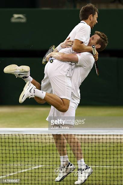Jonathan Marray of Great Britain and Frederik Nielsen of Denmark celebrate match point during their Gentleman's Doubles final match against Robert...