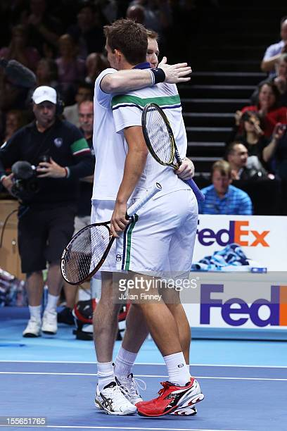 Jonathan Marray of Great Britain and Frederik Nielsen of Denmark celebrate their victory during the men's doubles match against Mahesh Bhupathi of...