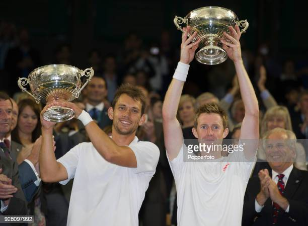 Jonathan Marray of Great Britain and Frederik Nielsen of Denmark with the men's doubles trophy after defeating Robert Lindstedt of Sweden and Horia...