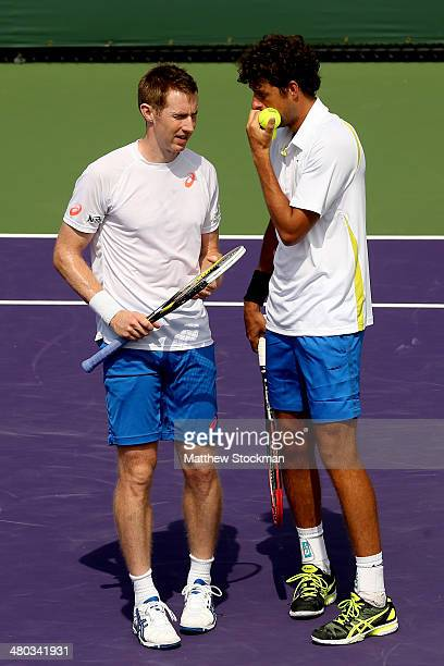 Jonathan Marray of Great Britain and Robin Hasse of Netherlands confer between points while playing Daniel Nestor of Canada and Nenad Zimonjic of...