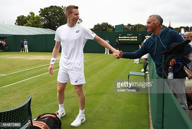 Jonathan Marray of Great Britain celebrates victory during the Men's Doubles first round match against Pablo Cuevas of Uraguay and Marcel Granollers...