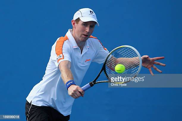 Jonathan Marray of Great Britain plays a backhand in his first round doubles match with Andre Sa of Brazil against Lukas Lacko and Igor Zelenay of...