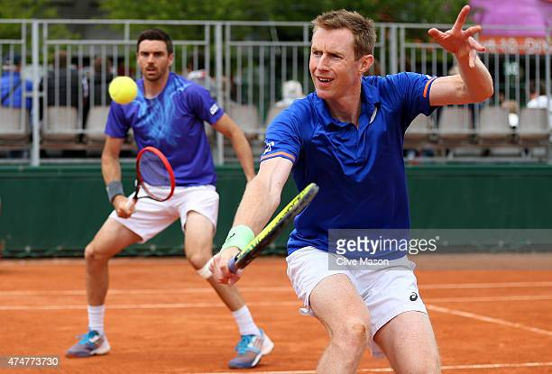 Jonathan Marray of Great Britain returns a shot next to his partner Colin Fleming of Great Britain during their men's doubles match against Feliciano...