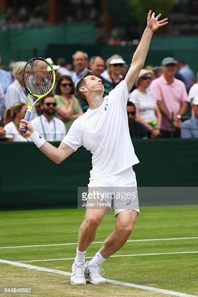 Jonathan Marray of Great Britain serves during the Men's Doubles first round match against Pablo Cuevas of Uraguay and Marcel Granollers of Spain on...