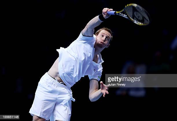 Jonathan Marray of Great Britain serves during the men's doubles match against Mahesh Bhupati of India and Rohan Bopanna of India on day two of the...