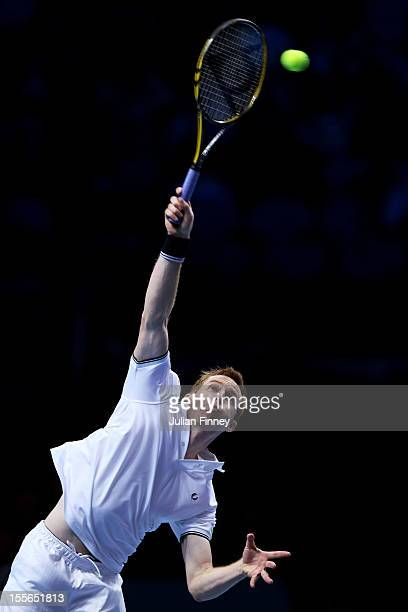 Jonathan Marray of Great Britain serves during the men's doubles match against Mahesh Buathi of India and Rohan Bopanna of India on day two of the...