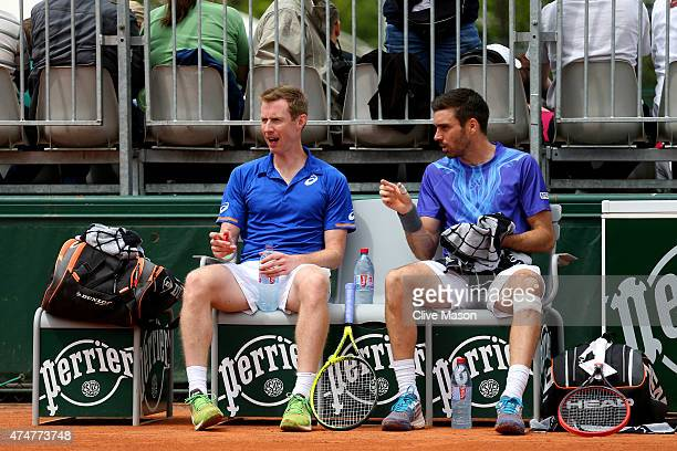 Jonathan Marray of Great Britain speaks with his partner Colin Fleming of Great Britain during a break in their men's doubles match against Feliciano...