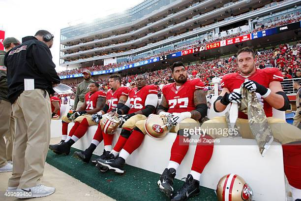 Jonathan Martin Alex Boone Marcus Martin Mike Iupati and Joe Staley of the San Francisco 49ers sit on the bench during the game against the...