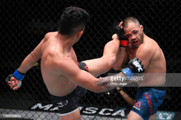 Jonathan Martinez kicks Frankie Saenz in their bantamweight fight during the UFC Fight Night event at UFC APEX on August 01, 2020 in Las Vegas,...