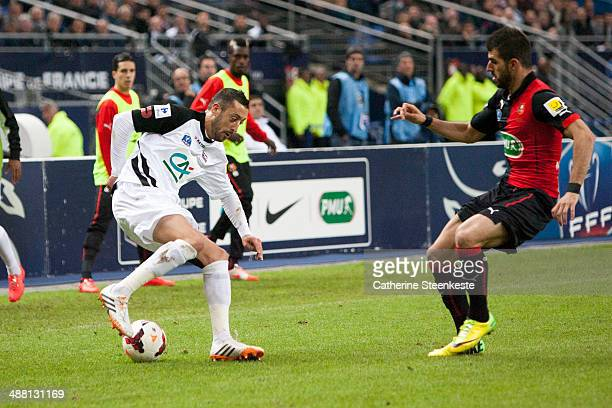 Jonathan Martins Pereira of EA Guingamp controls the ball against Nelson Oliveira of Stade Rennais FC during the French Cup Final match between Stade...