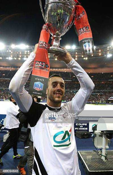 Jonathan Martins Pereira of Guingamp holds the trophy after the French Cup Final between Stade Rennais FC and EA Guingamp at Stade de France on May 3...