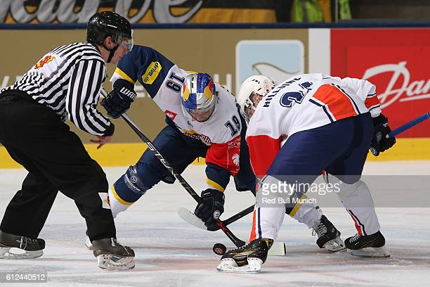 Jonathan Matsumoto of Munich and Joakim Hillding of Vaxjo during the Champions Hockey League Round of 32 match between Red Bull Munich and Vaxjo...