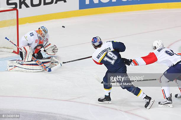 Jonathan Matsumoto of Munich and Victor Andren of Vaxjo during the Champions Hockey League Round of 32 match between Red Bull Munich and Vaxjo Lakers...