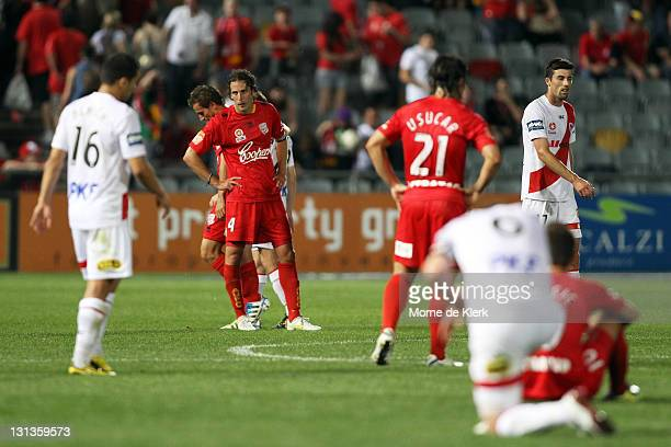 Jonathan McKain of Adelaide as well as other players from both side react after the round five A-League match between Adelaide United and the...