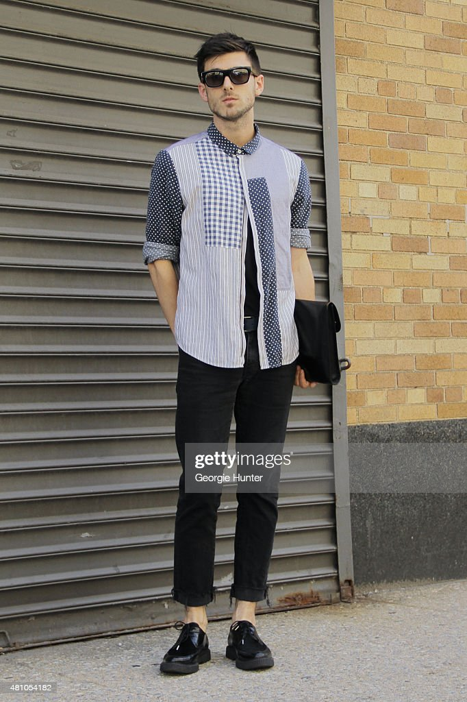 Jonathan McKenna seen at Skylight Clarkson Sq outside the Perry Ellis show wearing Richard Nicoll shirt, H&M jeans, a vintage New and Lingwood bag and Saint Laurent shoes and sunglasses during New York Fashion Week: Men's S/S 2016 on July 16, 2015 in New York City.
