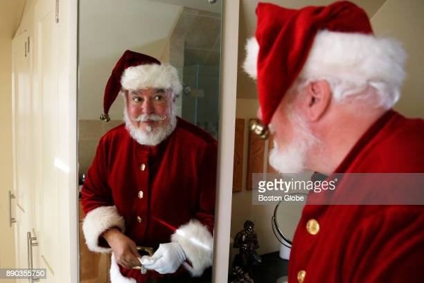 Jonathan Meath the cofounder of the New England Santa Society and the official Santa Claus for CocaCola poses for a portrait at his home in...