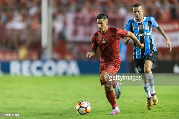 Jonathan Menendez of Independiente and Luan Vieira of Gremio battle for the ball during the first leg match between Independiente and Gremio as part...