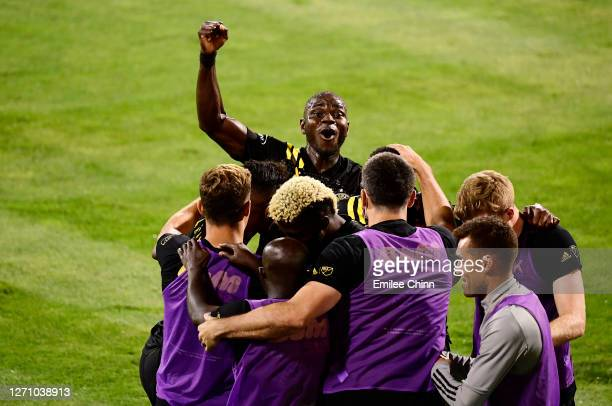 Jonathan Mensah and his teammates celebrate a goal by Gyasi Zardes of Columbus Crew in the second half during their game against FC Cincinnati at...