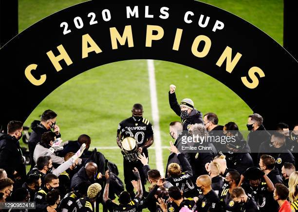 Jonathan Mensah of Columbus Crew brings his team the MLS Cup after a 3-0 win over the Seattle Sounders during the MLS Cup Final at MAPFRE Stadium on...
