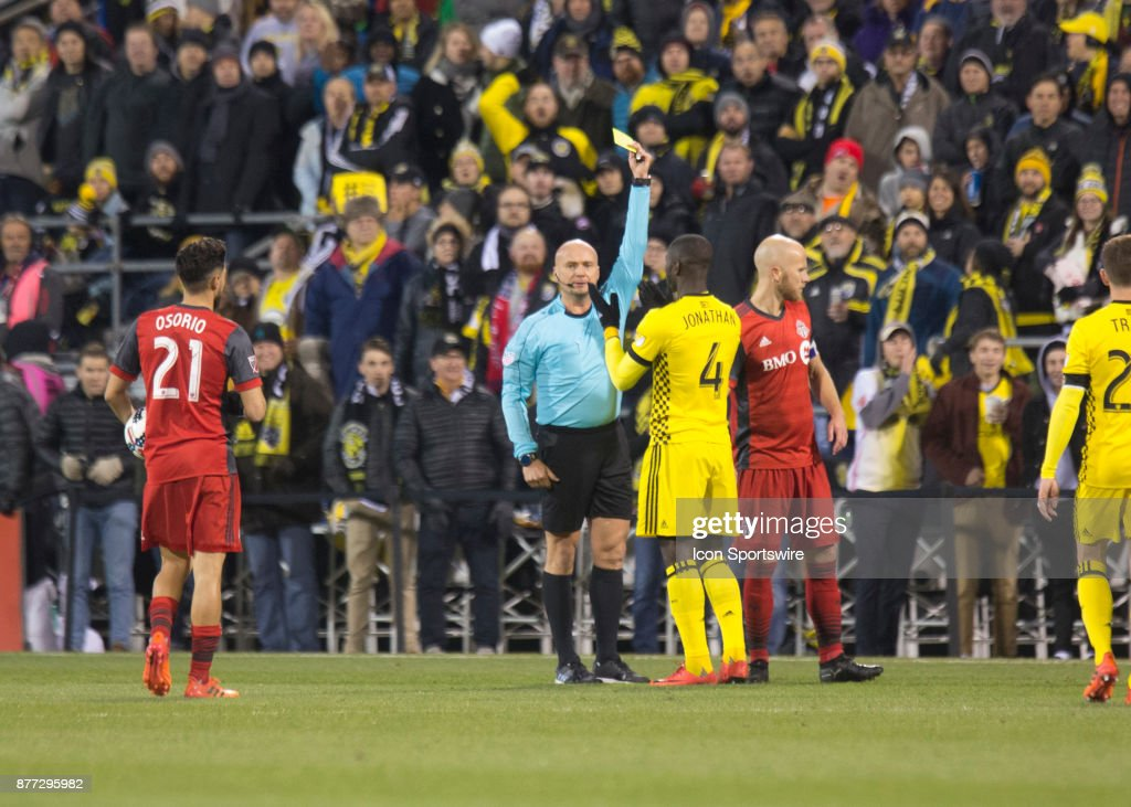 Jonathan Mensah #4 of Columbus Crew SC receives a yellow card during the first leg of the Eastern Conference Finals between the Columbus Crew SC and the Toronto FC at MAPFRE Stadium in Columbus, Ohio on November 21,2017. Columbus Crew SC and Toronto FC pay to a 0-0 tie.