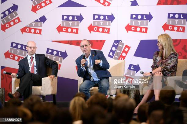 Jonathan Metzl Fred Guttenberg and Scottie Nell Hughes speak onstage during day 2 of Politicon 2019 at Music City Center on October 27 2019 in...