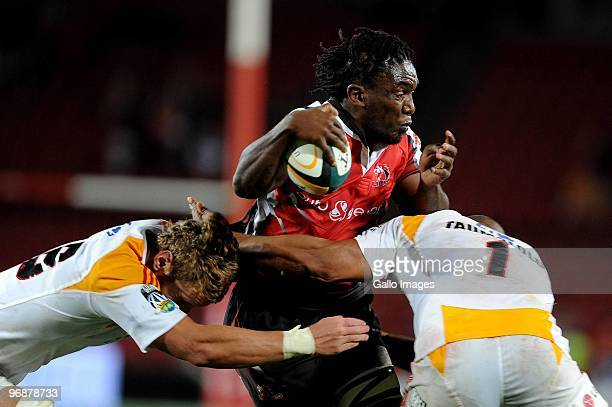 Jonathan Mokuena of Lions is tackle by Jarrad Hoeata and Sona Taumalolo of Chiefs during the Super 14 match between Auto and General Lions and Chiefs...