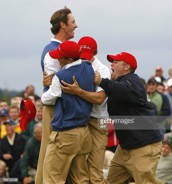 Jonathan Moore of USA celebrates with his teammates after putting for an eagle to retain the Walker Cup for the USA 09 September 2007 during the...