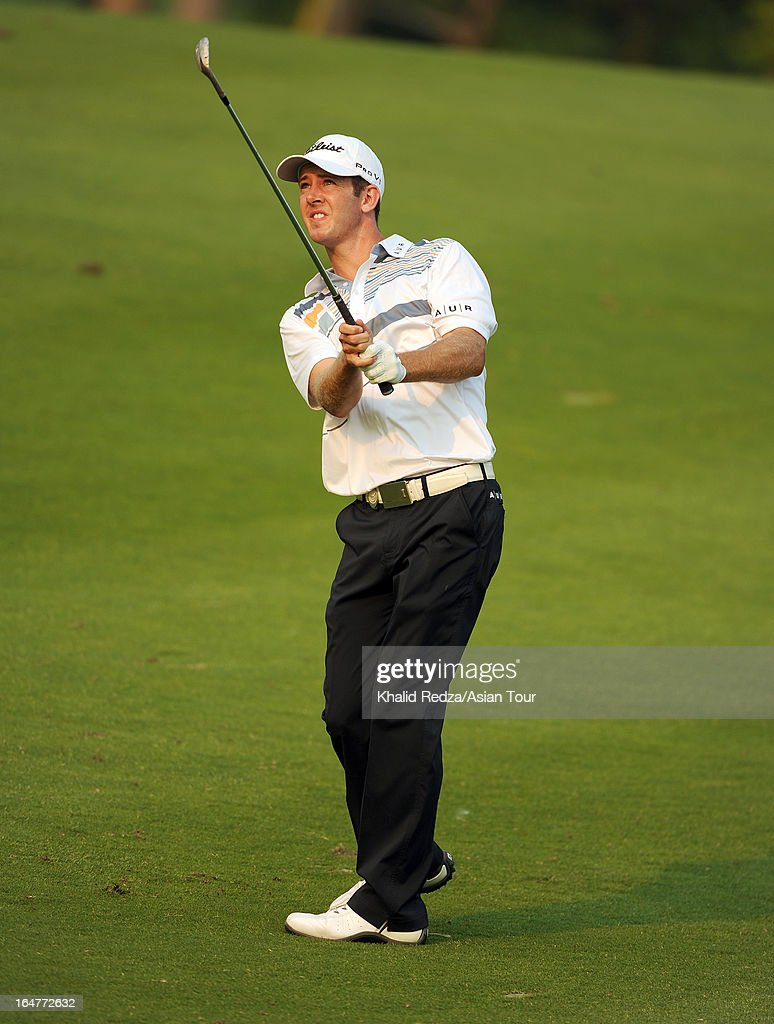 Jonathan Moore of USA plays a shot during round one of the Chiangmai Golf Classic at Alpine Golf Resort-Chiangmai on March 28, 2013 in Chiang Mai, Thailand.