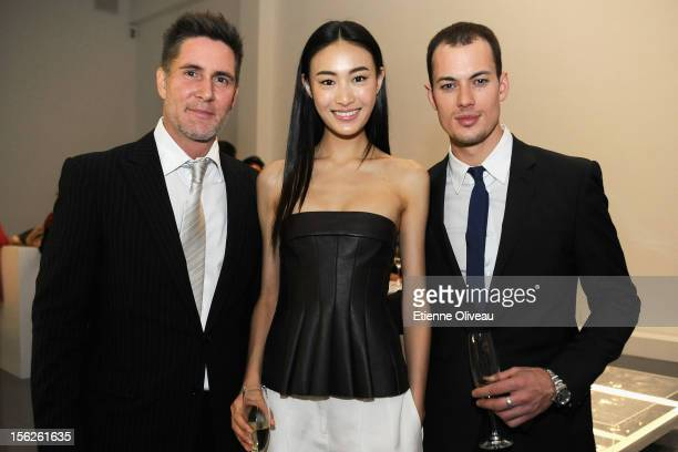 Jonathan Mork Supermodel Qin Shu Pei Jeremy O'Shea pose for pictures during the Calvin Klein special dinner at the Long March Space in 798 Art...