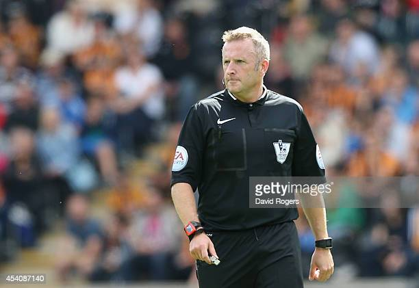 Jonathan Moss the referee looks on during the Barclays Premier League match between Hull City and Stoke City at the KC Stadium on August 24 2014 in...
