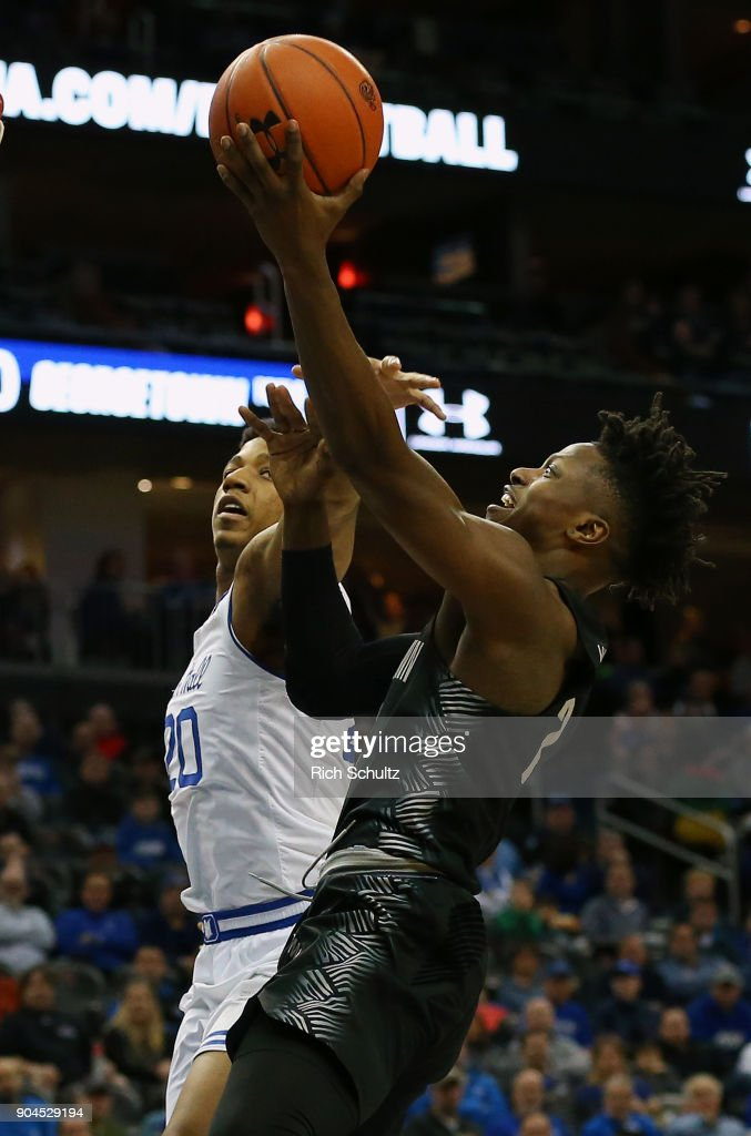 Jonathan Mulmore #2 of the Georgetown Hoyas attempts a shot as Desi Rodriguez #20 of the Seton Hall Pirates defends during the first half of a game at Prudential Center on January 13, 2018 in Newark, New Jersey.