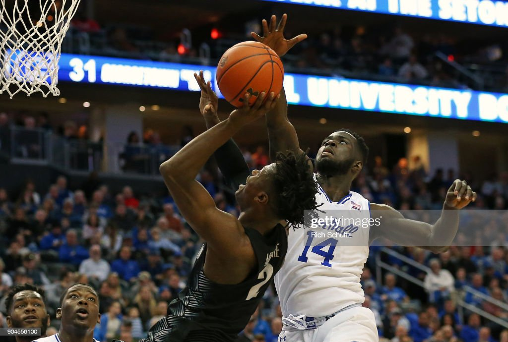 Jonathan Mulmore #2 of the Georgetown Hoyas attempts a shot as Ismael Sanogo #14 of the Seton Hall Pirates defend during the first half of a game at Prudential Center on January 13, 2018 in Newark, New Jersey. Seton Hall defeated Georgetown 74-61.