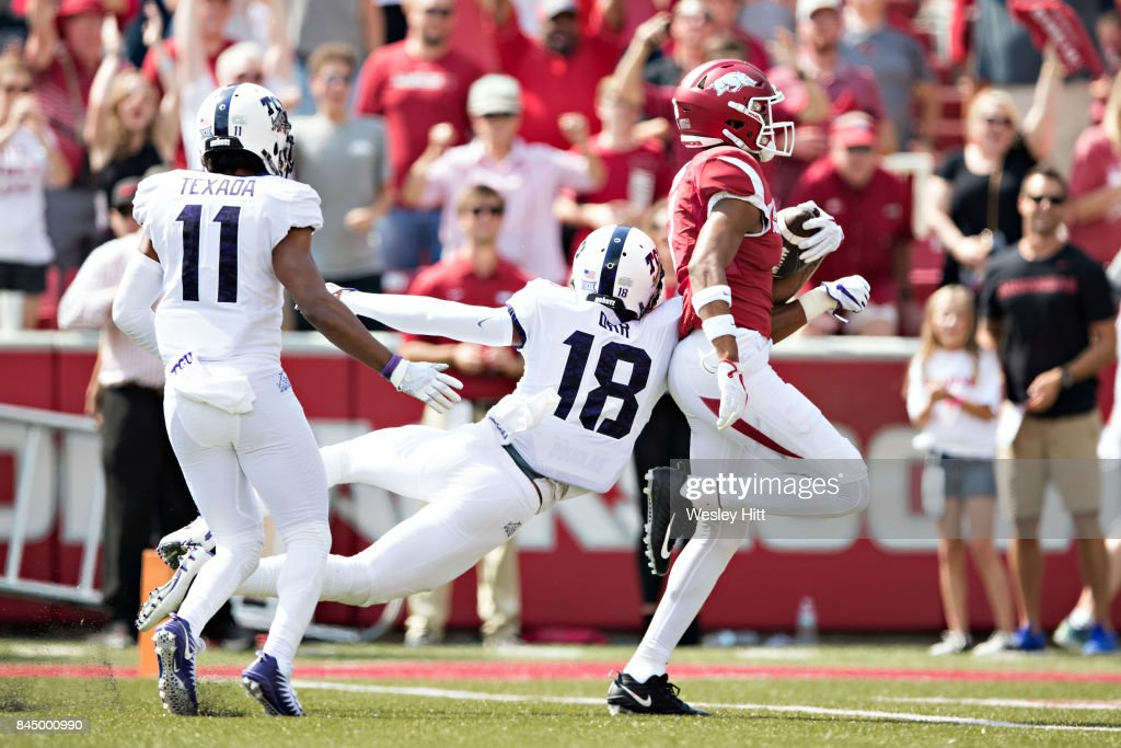 Jonathan Nance #7 of the Arkansas Razorbacks scores a touchdown after catching a pass in front of Nick Orr #18 of the TCU Horned Frogs at Donald W. Reynolds Razorback Stadium on September 9, 2017 in Fayetteville, Arkansas.