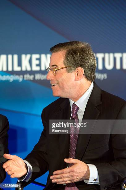 Jonathan Nelson chief executive officer of Providence Equity Partners Inc gestures as he speaks at the Milken Institute Asia Summit in Singapore on...