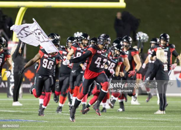 Jonathan Newsome leads the Ottawa Redblacks out onto the field against the Saskatchewan Roughriders The Saskatchewan Rough Riders defeated the Ottawa...