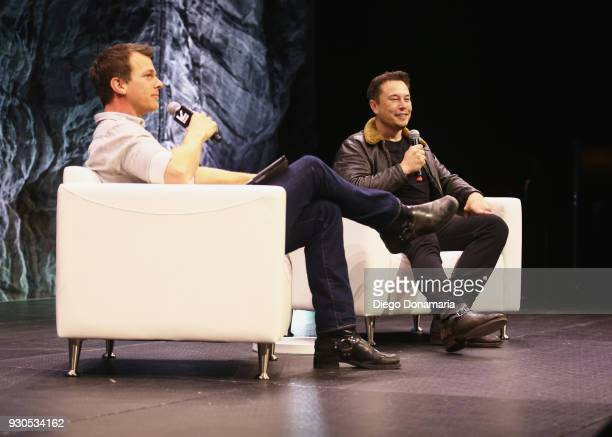 Jonathan Nolan and Elon Musk speak onstage at Elon Musk Answers Your Questions during SXSW at ACL Live on March 11 2018 in Austin Texas