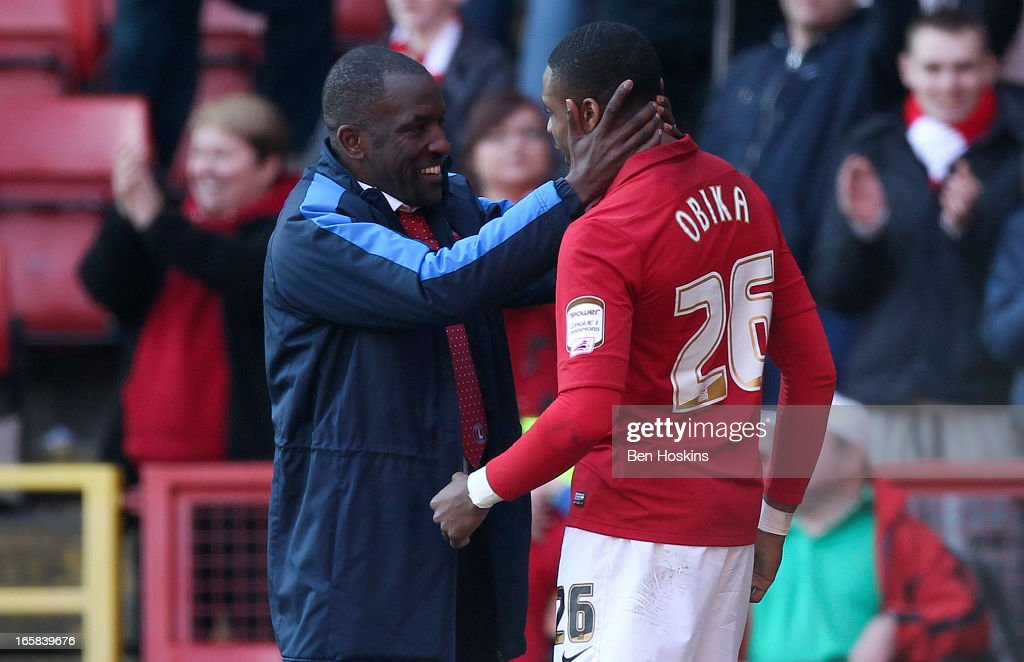 Jonathan Obika of Charlton (R) celebrates with his manager Chris Powell after the final whistle during the npower Championship match between Charlton Athletic and Leeds United at the Valley on April 06, 2013 in London, England.
