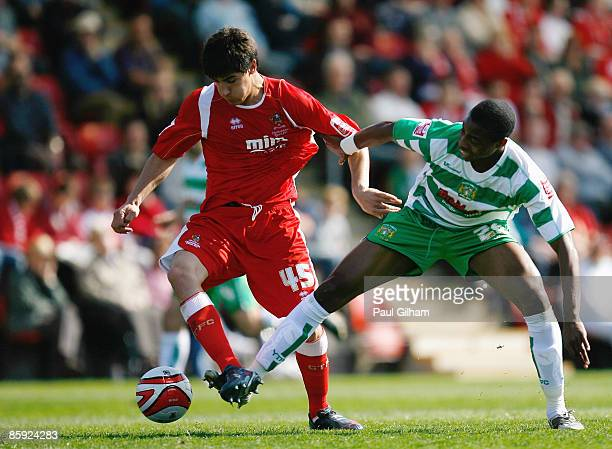 Jonathan Obika of Yeovil Town battles for the ball with Yuri Berchiche of Cheltenham Town during the Coca-Cola League One match between Cheltenham...