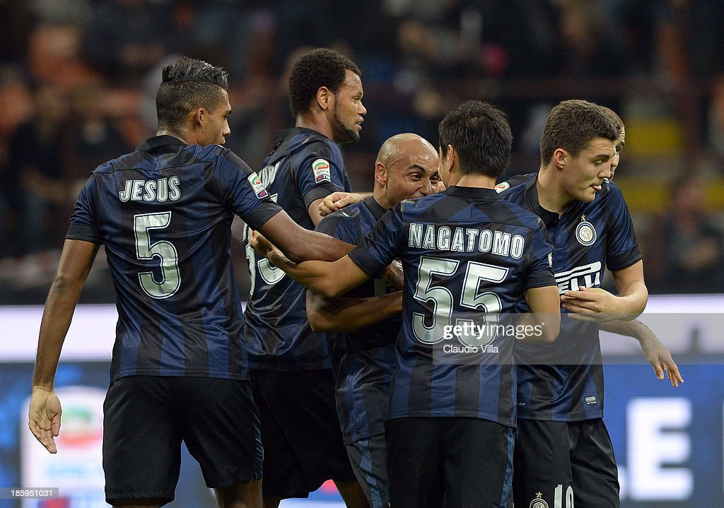 Jonathan of FC Inter Milan (C) celebrates with team-mates after their first goal is scored as an own goal by Hellas Verona FC during the Serie A match between FC Internazionale Milano and Hellas Verona at Stadio Giuseppe Meazza on October 26, 2013 in Milan, Italy.