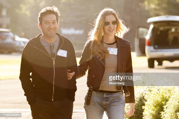 Jonathan Oringer chairman and chief executive officer of Shutterstock Inc left and Talia Oringer arrive for the morning session during the Allen Co...