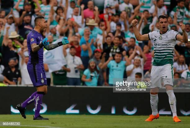 Jonathan Orozco and Gerardo Alcoba of Santos celebrate during the quarter finals second leg match between Santos Laguna and Tigres UANL as part of...